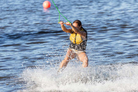 Woman study wakeboarding photo