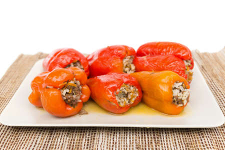 Freshly cooked peppers on a beige plate photo