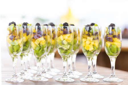 Fruit cuts in glasses photo