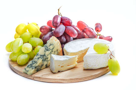 cheeseboard: nice cheese board with grapes on white background Stock Photo