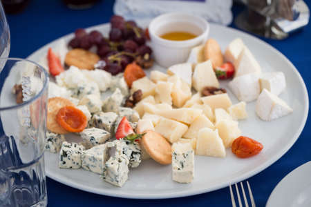 Perfect cheese board on the table for party photo