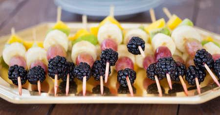 picks: Fresh tasty fruit cuts and berries on picks