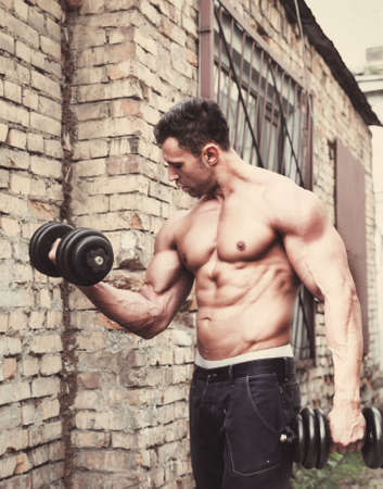 workout gym: Young Muscle man in sport training outdoors
