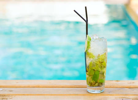 mohito: Mohito mojito drink with ice mint and lime near swimming pool Stock Photo