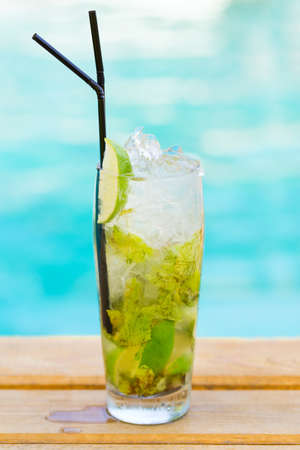 Mohito mojito drink with ice mint and lime near swimming pool Stock Photo