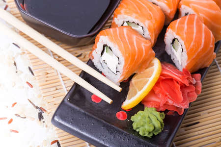 sushi plate: Salmon sushi rolls on a wooden background Stock Photo