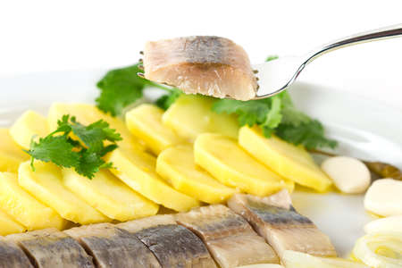 a portion: Portion of herring fish fillets with potato and onion Stock Photo