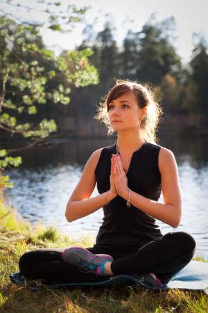 salutation: Pretty woman in Namaskarasana Salutation yoga pose Stock Photo