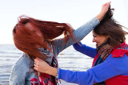 women fight: Fighting women near lake Stock Photo