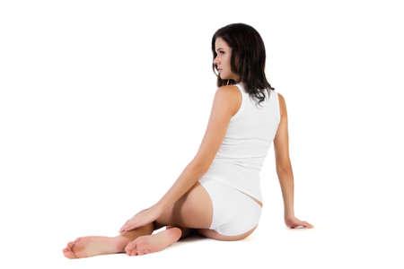 panties: Mujer hermosa joven en ropa interior de algod�n en el fondo blanco Foto de archivo