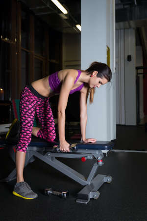 women working out: beautiful young women working out in the gym Stock Photo