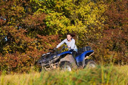 woman motorcycle: Elegant woman riding extreme quadrocycle ATV Stock Photo