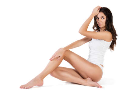 femme en sous vetements: Young beautiful woman in cotton underwear on white background