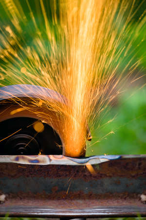 programmable: sharpening and cutting of iron by abrasive disk machine Stock Photo