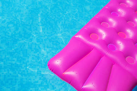 lilo: Pink air mattress in swimming pool. Holiday background. outdoors