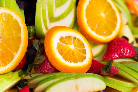 Fruit plate: Fruit plate orange apple grapes strawberries mint