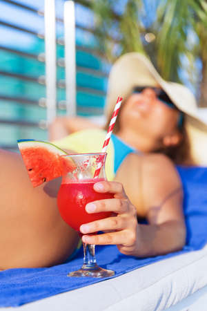 natural juices: Woman in hat holding water melon fresh juice smoothie drink cocktail