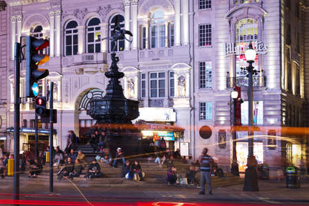 british touring car: United Kingdom, England, London - 2016 June 17: Popular tourist Picadilly circus with flags union jack in night lights illumination Editorial