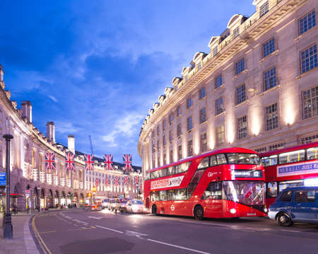 regent: United Kingdom, England, London - 2016 June 17: Popular tourist Regent street with flags union jack in night lights illumination