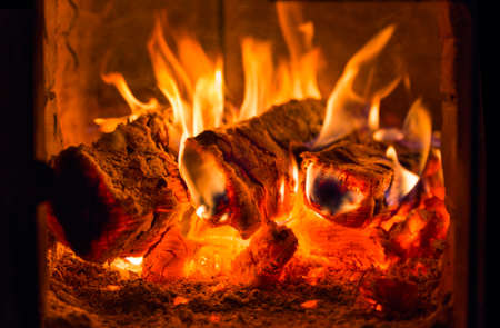 Bright fire burning with ash in fireplace Reklamní fotografie