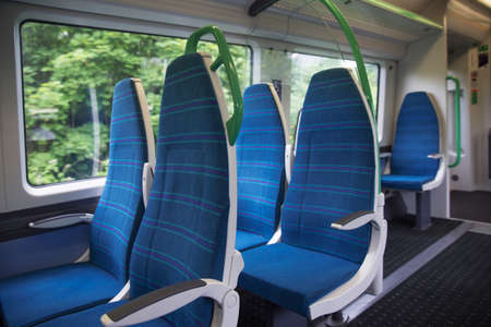 Electric train blue sits interior express Stock Photo