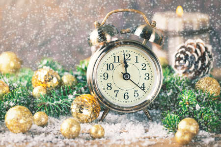 12 month old: Christmas countdown to new year Clock and balls and fir Stock Photo
