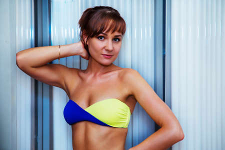 solarium: Pretty slim woman getting sun tan in solarium