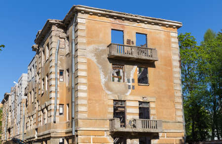 Russia, Saint-Petersburg - 15 May 2016: Abandoned building - broken tenement apartment house in daylight
