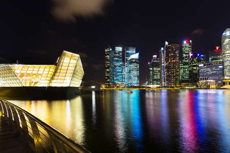 Singapore, Singapore - 15 January 2016: Landscape of Marina Bay hotel, bridge, museum and financial district at night Editorial