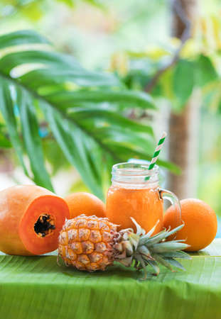 Tropical exotic pineapple papaya fruits juice Stock Photo