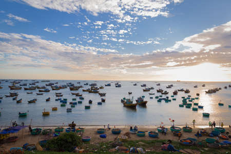 Vietnam Mui Ne village fishing boats and ships in sunset light