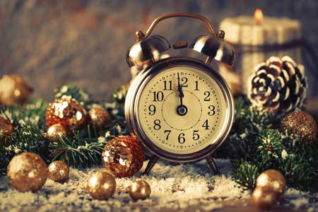 Christmas countdown to the new year. Clock and balls and fir spruce branches. Holiday composition. Stock Photo