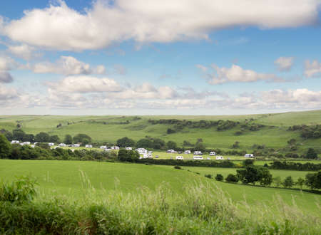 Caravan trailer camping in amazing green fields in Cornwall, England, United Kingdom