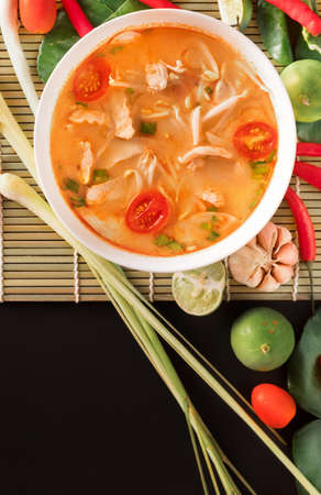Tom Yum Gai or spicy tom yum soup with chicken - Authentic Thai style food.