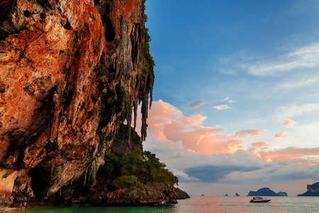 Popular travel tropical karst rocks perfect for climbing Phra Nang Cave Beach in sunset, Krabi province, Thailand