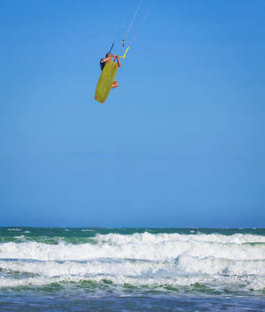 Young athletic man riding kite surf on a sea in Vietnam Stock Photo