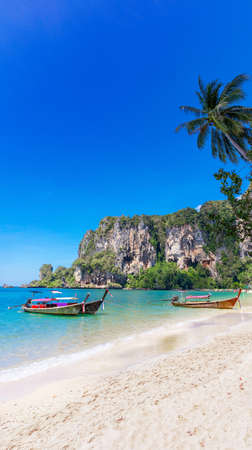 Amzing landscape with traditional longtail boats, rocks, cliffs, beautiful sea tropical and white Tonsai beach. Popular famous travel vacation destination Krabi Province, Thailand.