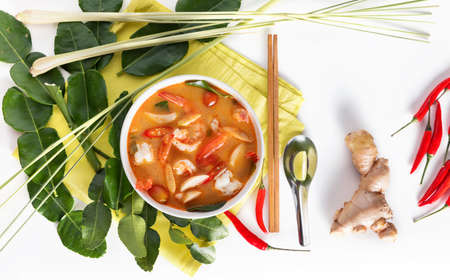 Tom Yum Goong or spicy tom yum soup with prawns shrimps - Authentic Thai style food. With ingredients: lemongrass, galangal, kaffir lime leaves, fresh chilies, and lime. Stock Photo