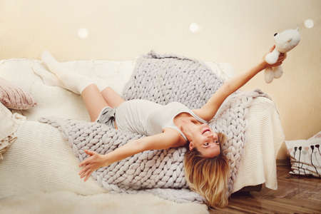 Happy pregnant woman relax on a soft sofa