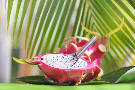 Fresh, tasty tropic, exotic dragon pitahya dragon fruit near palms ready to eat Stock Photo