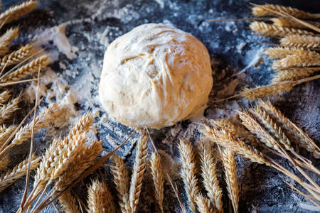 Knead the dough with the ingredients on a dark Stock Photo