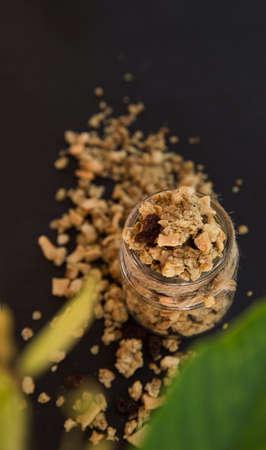 Fresh homemade tropical exotic granola muesli breakfast on black Stock Photo