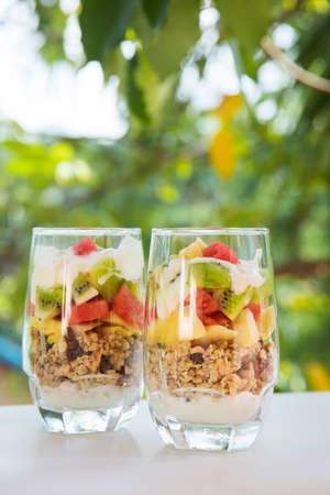 Fresh homemade tropical exotic granola muesli breakfast with fresh fruit cuts Stock Photo