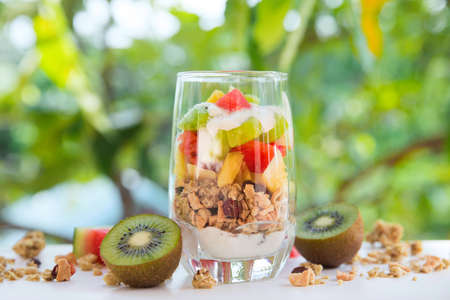 Fresh homemade tropical exotic granola muesli breakfast with fresh fruit cuts Stock Photo