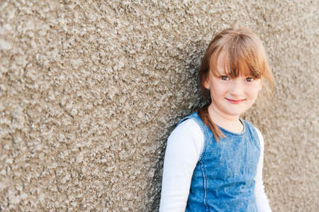 7 8 years: Outdoor portrait of a cute little girl Stock Photo