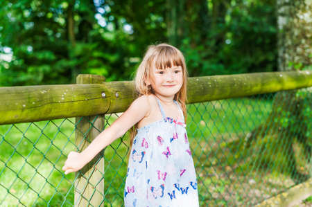 Summer portrait of a pretty little girl photo