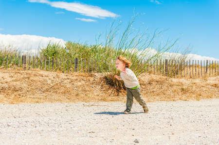 blond boy: Cute toddler boy having fun outdoors