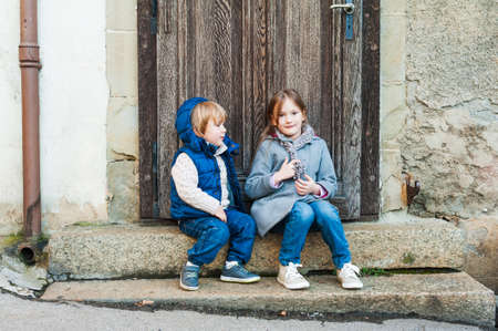 casual fashion: Outdoor portrait of a little girl and her brother Stock Photo