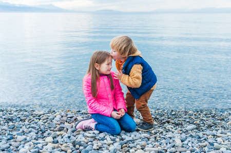 girl boots: Adorable children playing together outdoors