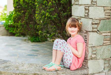 leggings: Outdoor portrait of a cute little girl Stock Photo